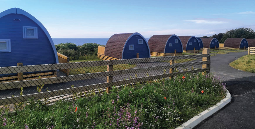 Glamping pods and beach